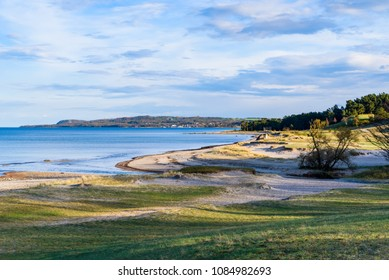 Havang, Sweden. Evening sunshine over the landscape with the hilltop of Stenshuvud national park visible in the distance.
