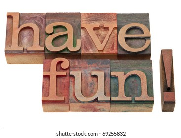have fun exclamation in vintage wooden letterpress printing blocks, stained by color inks, isolated on white