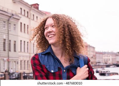 Have fun laughing young girl with curly hair