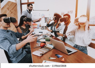 Have Fun. Virtual Reality Glasses. Look. Designers. Young Specialists. Choose Colors for Design. Teamwork. Discussion. Brainstorming. Design Studio. Multi-Ethnic. Project. Creative. Workplace.