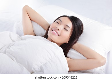 Have a good dream, Sleeping Girl on bed in the morning, model is a asian beauty