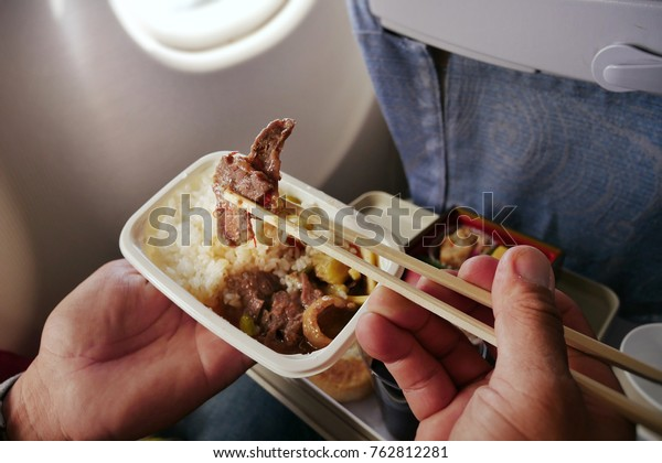 Have lunch on the plane, Stewed beef with rice in box set. Chinese food in flight.