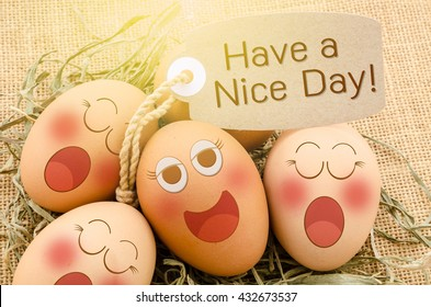 Have a nice day card and smile face eggs sleep with daylight on sack background.