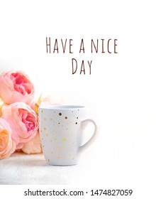Have a nice day. Cup of tea or Coffee and pink flowers on white background. minimalism theme good morning, romantic mood, congratulations card. soft selective focus
