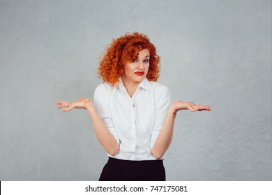 I have no idea. Portrait dumb looking woman arms out shrugs shoulders who cares so what I don't know isolated on gray wall background. Negative human emotion, facial expression body language attitude