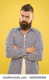 Have some doubts. Thoughtful bearded man on yellow background close up. Thoughtful expression. Need to think. Thoughtful man hesitating making decision. Hipster bearded face not sure in something.