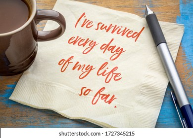 I have survived every day of my life so far - positive affirmation, inspirational handwriting on a napkin with a cup of coffee. Personal devleopment and motivation concept.