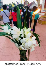 I have to walk, carry or pass lighted candles clockwise round a venerable person, too many people in the temple.