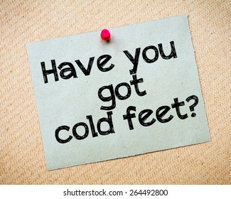 Have you got cold feet? Message. Recycled paper note pinned on cork board. Concept Image