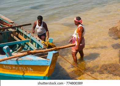 HAVELOCK ISLAND, ANDAMAN AND NICOBAR, INDIA 12 FEBRUARY 2016 : Local fishermen with boat in sea. Havelock Island is one of the premier tourist destination in the Andaman and Nicobar Islands, India