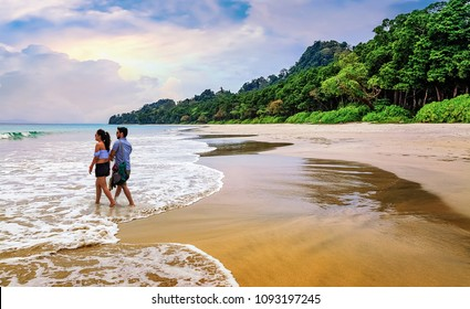 Havelock Islands, Andaman, India, March 23,2018: Honeymoon couple enjoy a romantic moment at the scenic Havelock islands beach at Andaman.