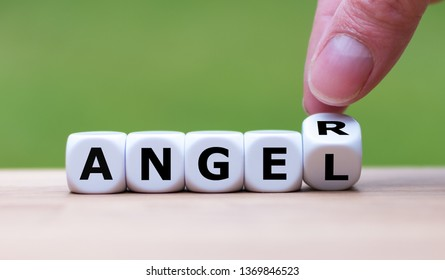 "Having anger or being an angel? Hand turns a dice and changes the word ""anger"" to ""angel""."