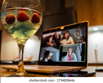 Having a cocktail with friends during a video call during the pandemic