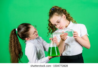 Having fun with chemistry. Educative experiment. Chemistry fun. Knowledge day. Schoolgirl with colorful chemical liquids. Education concept. Safety measures. Small kid study. Chemistry lesson.