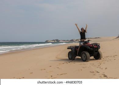 Having fun racing a quad bike along the desert beaches of Bazaruto Island, Mozambique