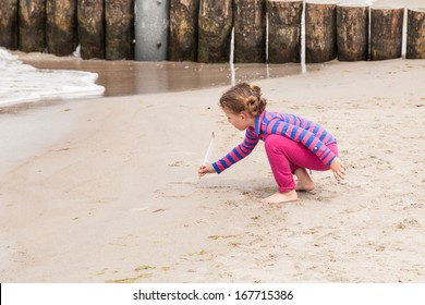 Having fun with sand on the beach.