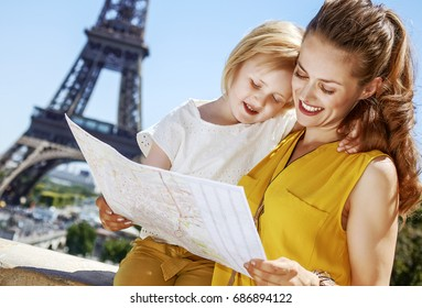 Having fun time near the world famous landmark in Paris. smiling mother and daughter exploring attractions in Paris, France