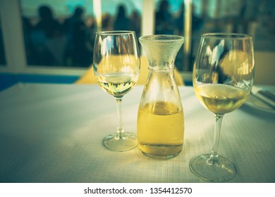 Having a glass of White wine in a typical fish restaurant. Relaxing time after a busy day – Image