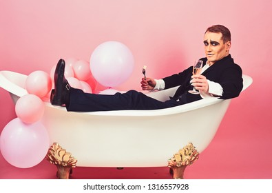 Having a good time. Comedian actor celebrate holidays. Mime actor enjoy bathing in bath tub. Mime man has celebration party with food and drink. Happy bubble bath day. Bathing and relaxing.