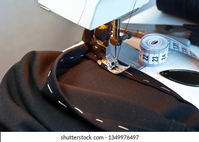Having hemmed black trousers on the sewing machine. Household. Close-up - Shutterstock ID 1349976497