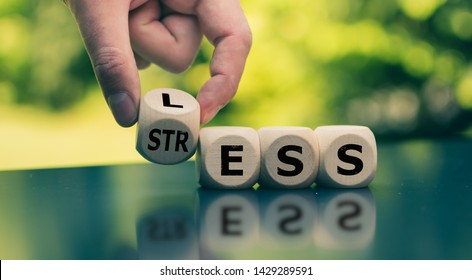 "Having less stress or being stress-less. Hand turns a cube and changes the word ""STRESS"" to ""LESS""."