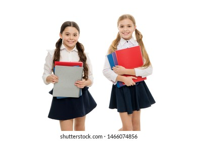 Having a mutual taste in literature. Cute literature readers. Adorable little schoolgirls holding books in English literature. Small primary school children studying foreign language and literature.