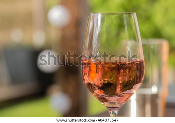 Having a nice glass of cold rose wine on a sunny day on the terrace, after work.