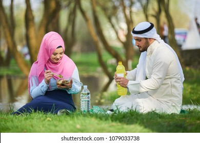 Having a picnic by the river. Arabic