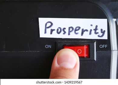 Having Prosperity concept. finger presses a button and turns on prosperity