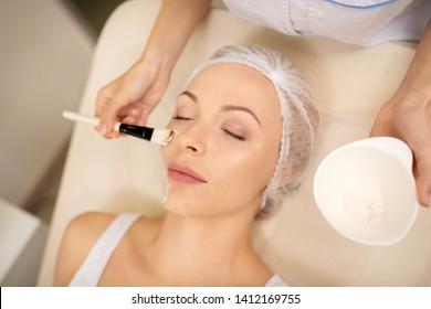 Having relax mask. Young businesswoman visiting cosmetologist and having relax mask