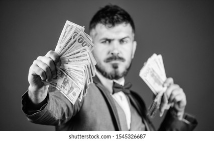 Having a rewarding job. Making money with his own business. Bearded man holding cash money. Currency broker with bundle of money. Rich businessman with us dollars banknotes. Business startup loan.