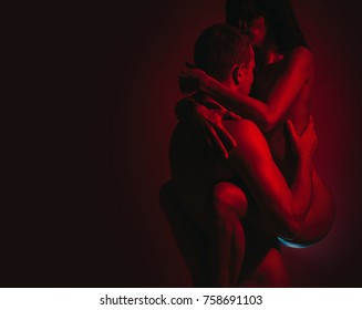 Having sex. Sex couple. Man flirting with woman. Kissing and playing in bed. Romantic home portrait of beautiful loving couple during pregnancy. Passionate concept. Fashion image. Sexy photo. Hot girl