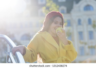 Having snack. Good nutrition essential good health. Kid girl eat apple fruit. Healthy diet. Snack while walk. Kids health and nutrition. Healthy snacking benefits. Snack between lunch and dinner.