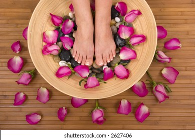 Having spa treatment (pedicure, massage and therapeutic mineral water bath)