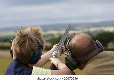 Having tuition the young boy aims the gun