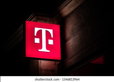HAVIROV, CZECH REPUBLIC - OCTOBER 24, 2019: The glowing logo of the T-Mobile telecommunication company providing 4G and 5G connection at night above on of its shops in Havirov