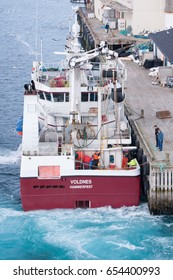 HAVOYSUND, NORWAY - APRIL 28, 2017: Fishing vessel from Hammerfest in the harbor of Havoysund, Norway. In Norway the sea is brimming with record-sized cod, halibut and salmon.