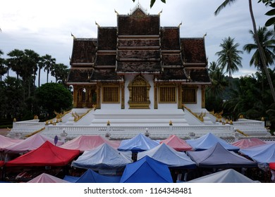 Haw Pha Bang in Luang Prabang. The Haw Pha Bang temple is on the grounds of the Royal Palace in Luang Prabang, Laos. The tents below line the street for around 1km for the night market.
