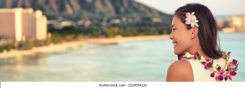 Hawaii Asian woman wearing lei necklace, hair flower for hula dancing luau party. Aloha girl at luxury resort sunset view of beach landscape, panorama banner. Hawaiian vacation summer travel.
