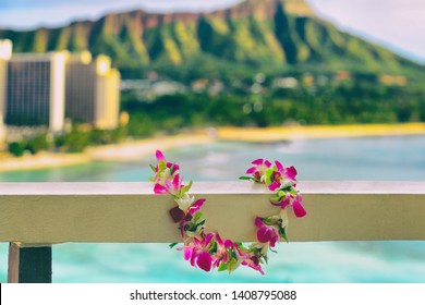 Hawaii background hawaiian flower lei with Waikiki beach landscape.