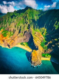 Hawaii beach, Kauai. Na pali coast aerial helicopter view from above. Hawaiian travel destinaton. Napali coastline in Kaui, Hawaii, USA. Aerial of Honopu arch.