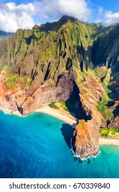 Hawaii beach, Kauai. Na pali coast view from helicopter. Hawaiian travel destinaton. Napali coastline in Kaui, Hawaii, USA. Aerial of Honopu arch.