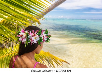 Hawaii beach woman luau dancer relaxing wearing wreath of fresh flowers on Tahiti Bora Bora, French Polynesia.