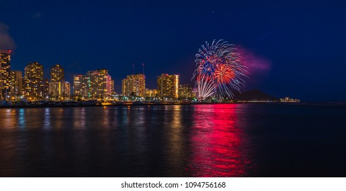 Hawaii fireworks light up the sky every week - see reflections of the waikiki skyline and lights in the ocean water