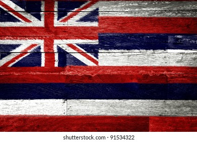 Hawaii flag painted on old wood background