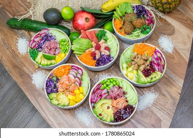 Hawaii food, poke bowls with rice, served with food decoration in a wooden table.