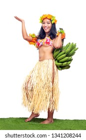 Hawaii Hula Dancer carries bunch of green bananas, isolated on white background. Ethnic women hold fresh tropical fruits.