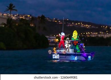 Hawaii Kai, HI, USA - December 15, 2018: Controversial boat #22 cruises the Hawaii Kai Marina during the Festival of Lights Boat Parade