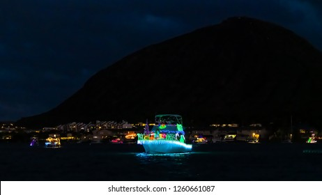 Hawaii Kai, HI, USA - December 15, 2018: Decorated boats cruised through the Hawaii Kai marina during the annual Festival of Lights Boat Parade
