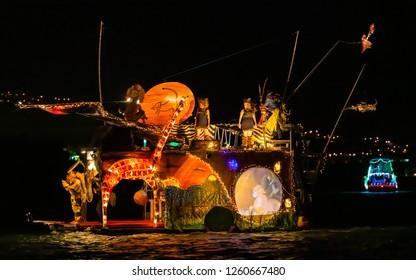 Hawaii Kai, HI, USA - December 15, 2018: Decorated boats cruised the Hawaii Kai marina during the 22nd Festival of Lights Boat Parade